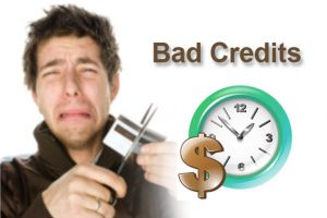 Man crying as he cuts up his credit card next to the words bad credit, clock and a gold dollar sign