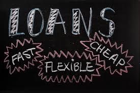 Blackboard with the words loans fast cheap flexible written on it - cheap loans