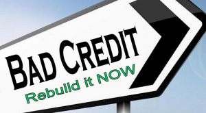 Street sign arrow with the words bad credit rebuild it now written on it - cheap loans